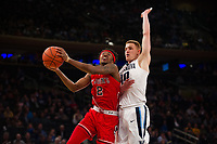 NEW YORK, NY - Thursday March 9, 2017: Shamorie Ponds (#2) of St. John's goes up for a basket against Donte DiVincenzo (#10) of Villanova as the two schools square off in the Quarterfinals of the Big East Tournament at Madison Square Garden.