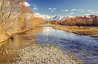A crisp winters morning looking up the Twizel River towards snow covered mountains in the Mackenzie Country,  Canterbury, South Island New Zealand