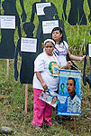 A woman placed a poster with a picture of her missing son in commemoration of the National Movement of Victims of State Crimes, MOVICE, commemorate this April 9 as the Day of Memory and Solidarity with Victims of state crimes in this time of vital importance to the country because it was from when triggered, significantly, the political conflict, social and armed, that today, after decades, continues in the form of persecution, threats and harassment against land claimants leaders and human rights defenders. In the district there are 13 mass graves containing more than 1000 dead buried in a dump that works in the area. The close calls that dump MOVISE and declare the area as a cemetery. In Colombia, this time away from a transitional or post. More than 60 leaders killed lands (at least 26 of these victims killed between 2010 and 2011), the reengineering of paramilitarism in over 400 municipalities, more than 1,400 displaced people killed since 2007, a development model based on dispossession and displacement.. In Medellín, Colombia. 09/04/2012. Photo by Fredy Amariles/VIEWpress.