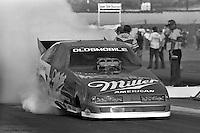 "POMONA, CALIFORNIA: Ed ""Ace"" McCulloch drives his Oldsmobile Funny Car during a 1985 NHRA drag race at Pomona, California."