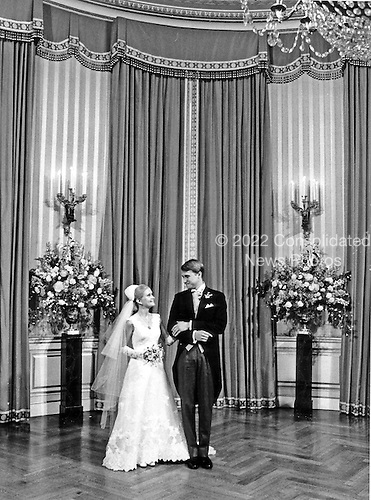 Washington, DC - June 12, 1971 -- Newlyweds Tricia Nixon Coxand Edward Cox pose for formal pictures in the White House on Saturday, June 12, 1971 following a Rose Garden wedding.  More than 400 friends and guests attended the glittering affair..Credit: Pool via CNP