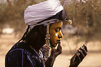 Akadaney, Niger, Africa - Fulani Wodaabe Dancer at Geerewol, preparing for Male Beauty Contest.