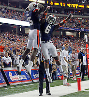 ATLANTA, GA - DECEMBER 31: Clint Moseley #15 of the Auburn Tigers celebrates with Jonathon Mincy #6 of the Auburn Tigers during the 2011 Chick Fil-A Bowl against the Virginia Cavaliers at the Georgia Dome on December 31, 2011 in Atlanta, Georgia. Auburn defeated Virginia 43-24. (Photo by Andrew Shurtleff/Getty Images) *** Local Caption *** Jonathon Mincy;Clint Moseley