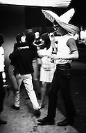 1967, Ciudad Acuna, Mexico --- American tourists intermingle with drag artists, female impersonators, and gay prostitutes in the red light district of Ciudad Acuna on the Texas-Mexico border. --- Image by © JP Laffont