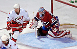 6 February 2007: Montreal Canadiens goaltender David Aebischer of Switzerland is screened by right wing forward Justin Williams (11) in the third period at the Bell Centre in Montreal, Canada. The Hurricanes went on to defeat the Canadiens 2-1.....Mandatory Photo Credit: Ed Wolfstein *** Editorial Sales through Icon Sports Media *** www.iconsportsmedia.com