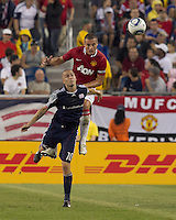 New England Revolution forward Rajko Lekic (10) and Manchester United FC defender Nemanja Vidic (15) battle for head ball. In a Herbalife World Football Challenge 2011 friendly match, Manchester United FC defeated the New England Revolution, 4-1, at Gillette Stadium on July 13, 2011.