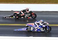 Mar 16, 2014; Gainesville, FL, USA; NHRA pro stock motorcycle rider Hector Arana Jr (near) races alongside Eddie Krawiec during the Gatornationals at Gainesville Raceway Mandatory Credit: Mark J. Rebilas-USA TODAY Sports
