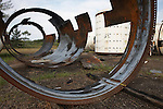 Rusting Europropulsion Ariane 5 rocket booster parts lie on tropical wasteland at European Space Agency's Kourou space center.