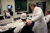 Scientists and technicians sit around a control panel that monitors a research reactor, containing highly-enriched uranium, at the Moscow Civic Engineering Institute.