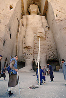A volleyball match between Hazara Mujahedins team at the foot of the Bamiyan Buddha of 54 meters high, in 1995..These magnificent colossal statues, created during the 3rd4th centuries A.D., attracted pilgrims for centuries, far beyond the time when Buddhism languished in India following the disastrous visitation of the Hephthalite Huns in the 5th century, the subsequent resurgence of Hinduism, and the arrival of iconoclastic Islam in the 7th century..The entire niche was once covered with paintings dating from i he late 5th to the early 7th centuries.