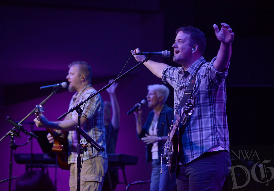 NWA Democrat-Gazette/BEN GOFF @NWABENGOFF<br /> Nathan Hicks (left) and Jon Moore sing praise as part of the worship team on Saturday June 4, 2016 during a ribbon-cutting and 'big reveal' for the newly renovated auditorium at New Life Christian Church in Bella Vista. The church was opened in 1974 as Bella Vista Christian Church and has undergone several expansions over the years. The church rebranded itself New Life Christian at the beginning of the year and began the renovation project for the auditorium on March 28.
