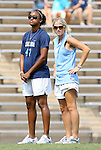 30 August 2009: Former UNC player Mandy Moraca (right) with Jessica McDonald (47). The University of North Carolina Tar Heels defeated the University of North Carolina Greensboro Spartans 1-0 at Fetzer Field in Chapel Hill, North Carolina in an NCAA Division I Women's college soccer game.