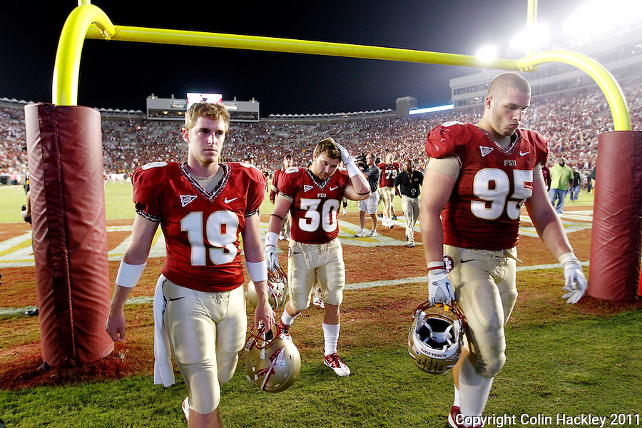 TALLAHASSEE, FL 9/17/11-FSU-OU091711 CH-Florida State's Ridge Read Tyler Hunter and Bjoern Werner leave the field after the 23-13 loss to Oklahoma Saturday at Doak Campbell Stadium in Tallahassee. COLIN HACKLEY PHOTO