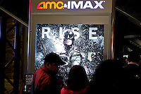 People attend the premier of 'Dark Knight Rises' after NYPD increased security at movie theaters in New York, July 20, 2012.  Photo by Eduardo Munoz Alvarez / VIEW.