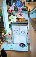 """Macy's flagship department store in Herald Square in New York is festooned with floral arrangements during the annual Macy's Flower Show on opening day Sunday, March 23, 2014. Shoppers flock to this year's show, whose them is """"The Secret Garden"""", which is being held indoors for the first time in two years after being held in a tent in front of the store while extensive renovations were going on. The show runs until Sunday, April 6.  (© Richard B. Levine)"""