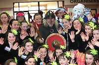 NO REPRO FEE: 28.1.12: Pictured were Over 55's accompanied by The Dancerite dance school from Rathcoole, Dublin who took part in the organisd Conga Line at the Holiday World Show at the RDS Simmonscourt. New to this year is the Over 55's Holiday show, joining The Holiday World Show and The Caravan and Motorhome Show, offering three great shows in one. The Show runs until 5.30pm on Sunday 29th January. Pictured was Frankie O'Gorman aka Brian Bru representing Shannon Development with dancers from Dancerite, Rathcoole. Picture Collins Photos.