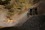 Mechanical digger and stone crushing machine used to widen road in La Gomera, Canary Islands,Spain.