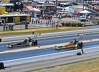 Jun 19, 2016; Bristol, TN, USA; NHRA top fuel driver Tony Schumacher (left) defeats J.R. Todd during the Thunder Valley Nationals at Bristol Dragway. Mandatory Credit: Mark J. Rebilas-USA TODAY Sports
