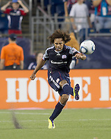 New England Revolution defender Kevin Alston (30) passes the ball. In a Major League Soccer (MLS) match, Chivas USA defeated the New England Revolution, 3-2, at Gillette Stadium on August 6, 2011.