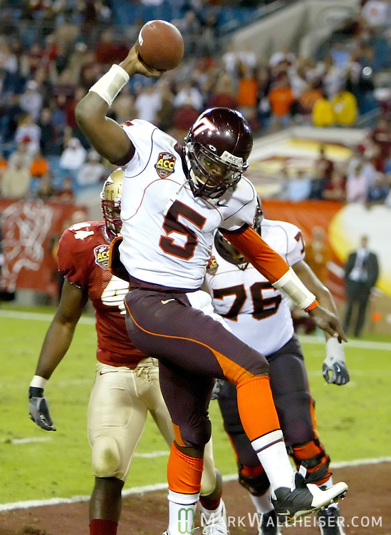 Virginia Tech University quarterback Marcus Vick (5) celebrates his five-yard fourth quarter rushing touchdown against Florida State University in the inaugural Atlantic Coast Conference championship NCAA football game in Jacksonville, Florida December 3, 2005. Vick was penalized for excessive celebration following the play.