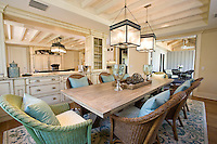 Driftwood finish dining table and comfy casual wicker chairs are casual and relaxing mixed together
