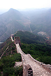 The Great Wall of China is a series of stone and earthen fortifications in northern China, built, rebuilt, and maintained between the 5th century BC and the 16th century to protect the northern borders of the Chinese Empire from attack from the Mongols of the North.  The Great Wall currently stretches over approximately 6,400 km - It has been estimated that somewhere in the range of 2 to 3 million Chinese died in building the wall over the course of centures - Before the use of bricks, the Great Wall was mainly built from Earth or Taipa, stones, and wood. During the Ming Dynasty, bricks were heavily used in many areas of the wall, as were materials such as tiles, lime, and stone.
