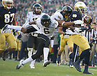Nov. 17, 2012; Running back Cierre Wood gains 20 yards before getting tackled by Wake Forest cornerbacks Chibuikem Okoro (6) and Kevin Johnson during the first quarter. Photo by Barbara Johnston/University of Notre Dame