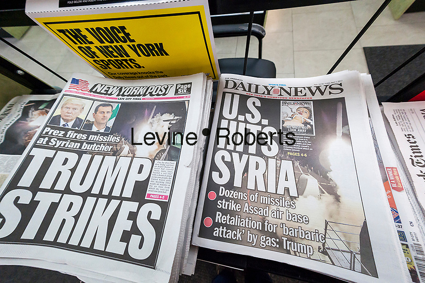 The New York Daily News, the New York Post and other papers report on Friday, April 7, 2017 on the previous evening's bombing of a Syrian air base in retaliation for the Assad government using chemical weapons. (© Richard B. Levine)