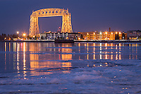 &quot;Twilight in Canal Park&quot;<br /> Canal Park is aglow at twilight, reflecting winter's stunning beauty. Stacks of plate ice reach out from shore, awaiting sunrise.