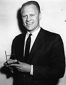 Ann Arbor, MI - FILE -- United States Representative Gerald R. Ford, Jr. (Republican of Michigan), poses with his Sports Illustrated Silver Anniversary Award. Date: December 21, 1959<br /> Credit: Courtesy Gerald R. Ford Library via CNP