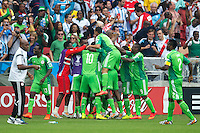 Ahmed Musa of Nigeria celebrates scoring a goal with his team mates after making it 2-2