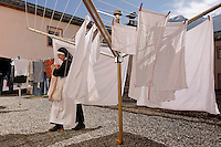 Monday is laundry day at Val Mustiar is a world-famous Benedictine Convent of St. John.  Eleven Benedictine nuns make their home behind closed walls, living a life of commitment to poverty and celebacy. <br /> <br /> Val Mustiar is a world-famous Benedictine Convent of St. John, which is a UNESCO World Heritage Site.  The alpine monastery was founded by Charlemagne, was built in the 8th centruy, the church houses the world's richest and best preserved series of figuratives Romanesque murals with impressive Carolingian frescos..Since the 12th century the monastery is run by Benedictine nuns.  Eleven make their home behind closed walls, living a life of commitment to poverty and vcelebacy. <br /> Monday is laundry day.  Sister Hyacynth helps Sister ... who has worked in the laundry for 20 years. The nuns speak a variation of the Romanche language. The dialect changes from valley to valley from Mustair to St. Moritz.