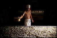 A sake brewer goes through the process of making Koji which is sprinkling mould onto cooled steamed rice to produce enzymes which converts carbohydate to sugar inside the Urakasumi Sake Brewery, Shiogama, Miyagi.  The brewery was hit by the tsunami in March 2011, Photo By Andrew Parsons/ i-Images