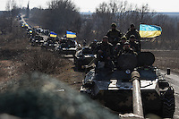 Ukrainian military convoy moving towards new positions during the withdrawal of heavy weapons. Near Artemovsk, Eastern Ukraine. Friday, 27 February 2015.