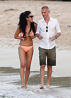 Kimora Lee with mystery man while on vacation with ex Russell Simmons in Saint Barths