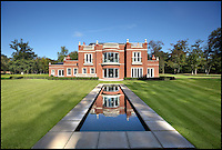 BNPS.co.uk (01202 558833)<br /> Pic: KnightFrank/BNPS<br /> <br /> ***Please use full byline***<br /> <br /> Abbotts Wood near Taplow, Bucks., a Palladian style house set in 56 acres on the market for &pound;7.5m. <br /> <br /> To the Manor Reborn...<br /> <br /> Britain's super rich are turning their backs on the decaying stately piles beloved by the aristocracy and building brand new modern mansions on their country estates.<br /> <br /> Rather than investing in the leaky roofs and draughty windows of days gone by, modern millionaires are choosing to build plush pads from the ground up.<br /> <br /> And they are filling their dream homes with every conceivable luxury without the need for a bottomless sink fund to pay for the costly upkeep of older houses.<br /> <br /> Estate agents specialising in top-end properties have reported a clear swing from grand Victorian manor houses to state of the art modern homes kitted out with all the mod cons.<br /> <br /> The multi-million pounds properties have been popping up across the country over the past few years - and are now being heralded as the stately homes of the future.