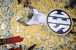 Ole Miss' Nick Williams (20) celebrates beating Florida in the SEC championship game at Bridgestone Arena in Nashville, Tenn. on Sunday, March 17, 2013. Ole Miss won 66-63.