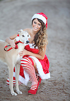 NO REPRO FEE. 1/11/2011.Christmas Cracker Miss Universe Ireland Aoife Hannon and some of Irelands Greyhounds took to the track today at Shelbourne Park in their sleigh to launch Christmas Nights at the Dogs. The Irish Greyhound Board are launching Christmas Party Night at the Dogs at their Greyhound Stadia around the Country, encouraging everyone to book a fun night at the dogs to celebrate  the festive season. With Packages to suit every pocket from restaurant dining to drinks with the lads, it really is heart racing stuff. For more information please contact Claire O Grady insight Consultants claire@insightconsultants.ie. Picture James Horan/Collins Photo Agency