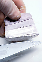 SODIUM METAL CUT WITH KNIFE<br /> Highly Reactive Alkalai Metal<br /> Sodium metal has a silvery appearance when freshly cut but quickly tarnishes as it is exposed to air. Due to its highly reactive properties, sodium metal is stored in oil.