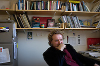 "Dr. Andreas Mershin, professor in MIT's Biological Engineering Department, sits in his office at MIT in Cambridge, Massachusetts, USA.  Mershin's current research focuses on photosynthetic photovoltaic power systems.  ""We would like to be able to grow solar power,"" says Mershin, ""Nighttime access to light is the best way out of poverty."""