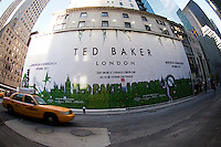 A billboard on a construction shed announced the imminent arrival of a Ted Baker clothing store on Fifth Avenue in New York on Black Friday, the day after Thanksgiving, Friday, November 25, 2011. Ted Baker Plc's  CFO Lindsay Page recently announced that the company expects improved sales during the holiday shopping season. (© Frances M. Roberts)