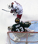 1/29/05  Omaha, NE University of Nebraska at Omaha's Alex Nikiforuk watches a shot go off Wayne State goalie Matt Kelly  . (photo by Chris Machian/ Prarie Pixel Group)