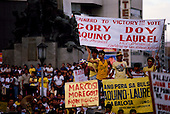 Manila, Philippines<br /> February 1986<br /> <br /> Corazon Aquino campaigning for President of the Philippines in 1986.<br /> <br /> Corazon Aquino was born into one of the wealthiest families in the Philippines, Mrs. Aquino began her political education by playing the dutiful wife as the political career of her husband, Benigno Aquino Jr., expanded. In less than 20 years he emerged as one of the chief potential rivals of Mr. Marcos, who was then president. When Mr. Marcos declared martial law in 1972, her husband was arrested and imprisoned for seven years. .He was assassinated in 1983 after returning to the Philippines from a three-year exile in the United States. Mr. Marcos was widely blamed for the murder. It was at Mr. Aquino's funeral that Mrs. Aquino, became a national symbol, demonstrating the dignity and composure that would characterize her most difficult moments as president. <br /> <br /> Mrs. Aquino came to power through what amounted to popular acclaim -- what the Philippino people called &quot;people power&quot; -- expressed by huge crowds that gathered in support of her. Her popularity reached its peak during her presidential campaign against Mr. Marcos in January 1986, when she was surrounded by enthusiastic crowds chanting, &quot;Cory! Cory! Cory!'&quot;<br /> <br /> Her act of knocking down a dictator and bringing democracy to the Philippines was a high point in the country's modern history, and it offered a model for nonviolent uprisings that has been repeated often in other countries.<br /> <br /> Mrs. Aquino, was often criticized as an indecisive and ineffectual leader. But she combined passivity and stubbornness and an unexpected shrewdness to hold firm against powerful opponents from both the right and the left, and one of her greatest accomplishments as president was fending off a half dozen coup attempts. <br /> <br /> The restoration of democracy, and the transition to a new president, were Mrs. Aquino's prime legacies. Yet she led demonstrations against all 3 of her successors.<br /> <br /> She died on July 31, 2009.