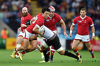 Nathan Hirayama of Canada is tackled in possession. Rugby World Cup Pool D match between Canada and Romania on October 6, 2015 at Leicester City Stadium in Leicester, England. Photo by: Patrick Khachfe / Onside Images