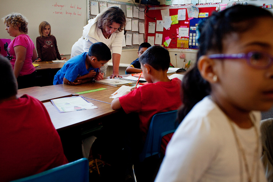 """Oceano, California, November 1, 2011 - Teacher Marcia Bess works with her 2nd grade class at Oceano Elementary School. As a part of an effort to help bridge some of the contrasts in school performance here, the 10,800-student school district of Lucia Mar recently became the first in California to adopt, in four of its schools, the Teacher Advancement Program (TAP) school-reform initiative. The complex model couples professional development, teacher observations keyed to a set of teaching standards and  leadership opportunities for teachers. Bess says she was origianlly leary of the TAP program, but now says she loves it. Adding, """"We were nervous with the talk about merit pay, but now I really don't care. I am having fun teaching again. There are so many fresh ideas that are getting students motivated. I just love it."""""""