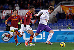 Calcio, Serie A: Roma vs Fiorentina. Roma, stadio Olimpico, 8 dicembre 2012..Fiorentina forward Haris Seferovic, of Switzerland, right, is chased by AS Roma defenders Marquinhos, of Brazil, center, and Ivan Piris, of Paraguay, during the Italian Serie A football match between AS Roma and Fiorentina at Rome's Olympic stadium, 8 december 2012..UPDATE IMAGES PRESS/Isabella Bonotto