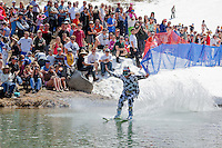 """Cushing Classic at Squaw Valley 16"" - Photograph of a skier crossing a pond during the Cushing Classic at Squaw Valley, USA."