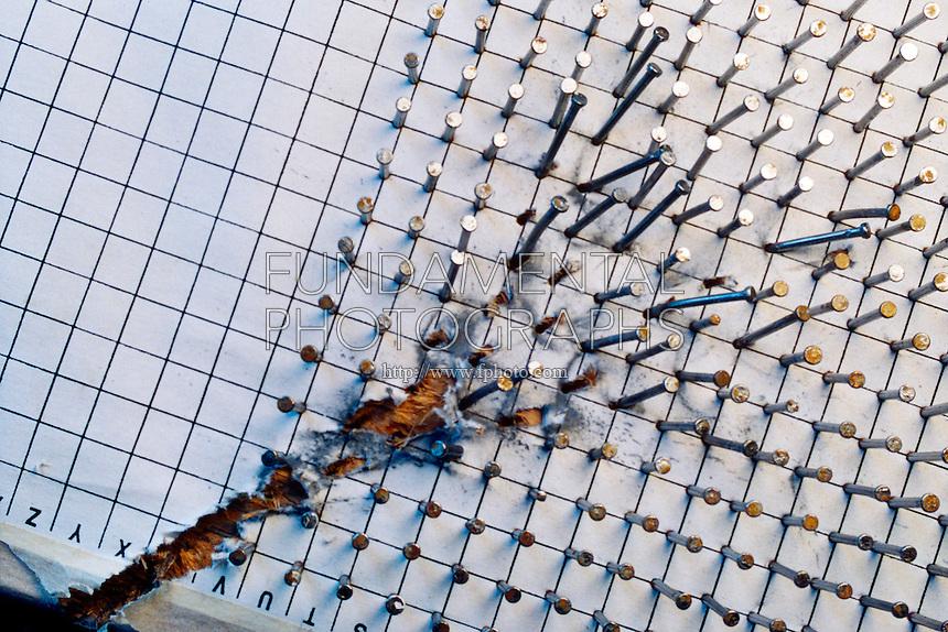 FIRED BULLET DAMAGE<br /> Dispersal Pattern of .22 Bullet<br /> .22 caliber bullet travels thru grid.