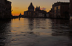 Early morning on the Grand Canal in Venice, Italy.Showing San Maria della Salute with dome covered in scaffolding. April 2007