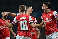FUSSBALL   CHAMPIONS LEAGUE   VORRUNDE     SAISON 2013/2014    Arsenal London - SSC Neapel   01.10.2013 Mesut Oezil (Mitte) bejubelt seinen Treffer zum 1:0 mit Aaron Ramsey (li) und Olivier Giroud (re, beide Arsenal)